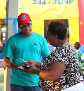 D.C. Chapter volunteer speaking with a woman from community at National Night Out event.